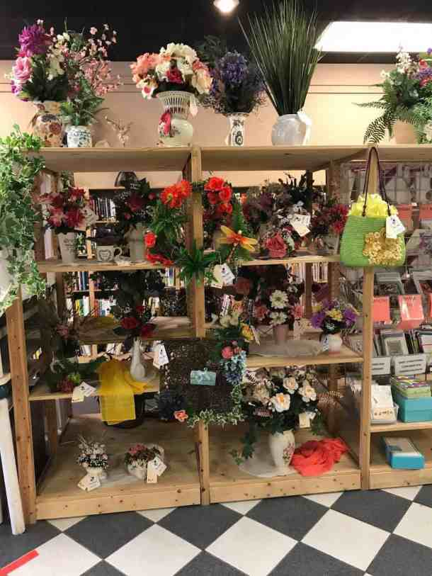 Display of artificial flower arrangements at North Raleigh Ministries