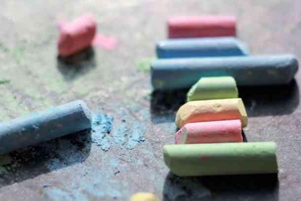 colorful sidewalk chalk on sidewalk