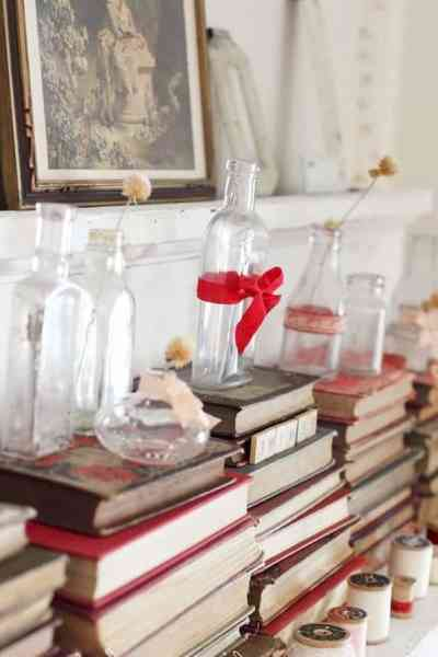 Simply turn books around and stack them. Add small vases and tie red ribbon to make this a Valentine's Day Decor item. #valentinesdaydecor #valentinesday