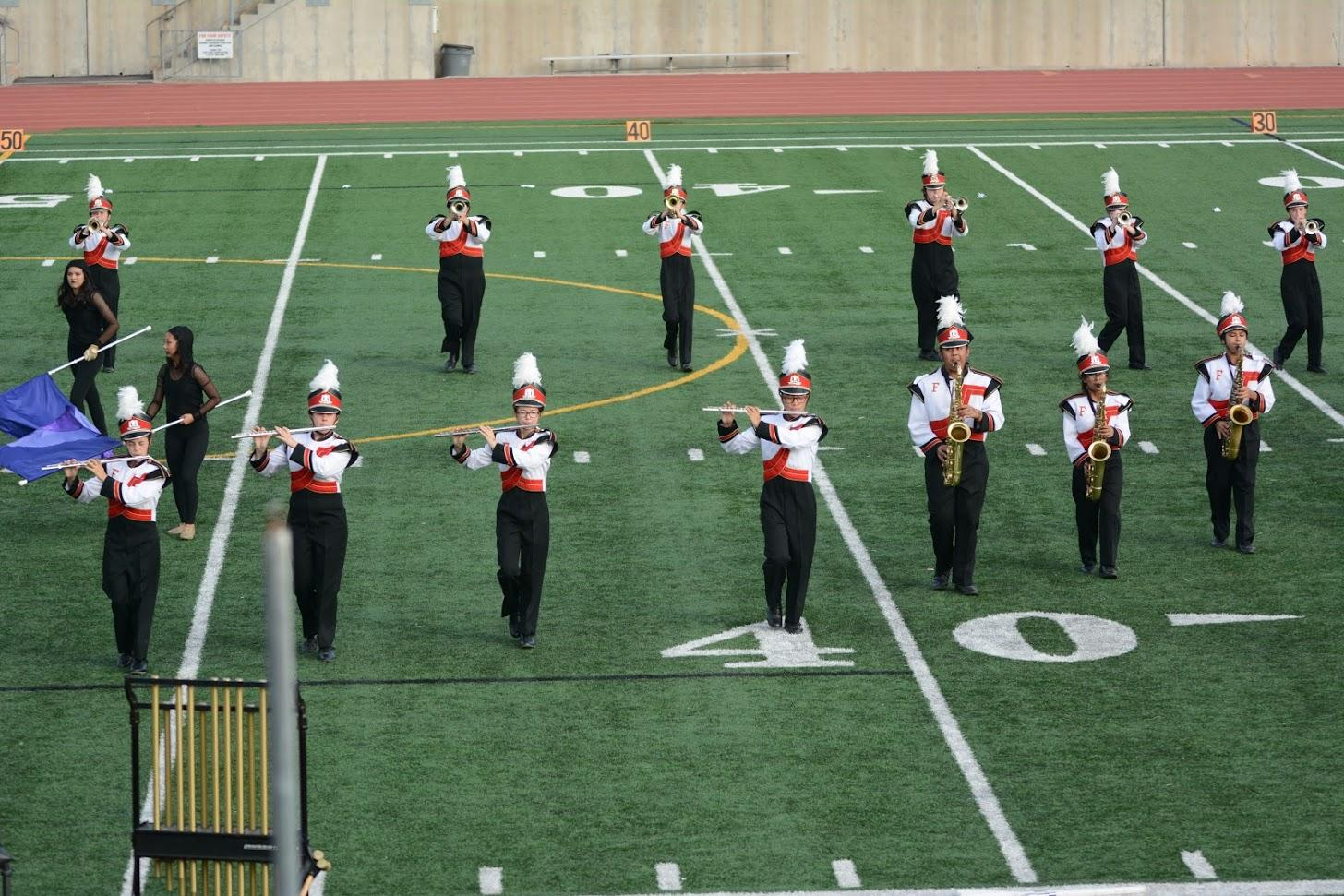 "The band performs their show ""Imprints"" at the Newport Harbor Open Tournament. Photo by Helen Craft."