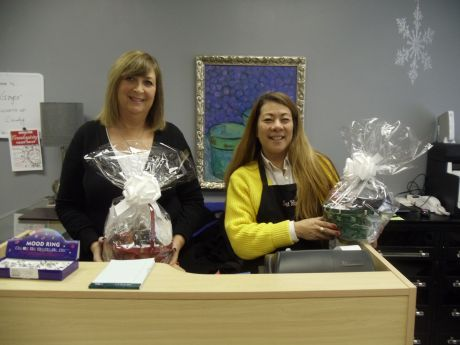 Photo:  (Left) Ilene Disch and (Right) Denise Peterson, proprietors of Sweet Things in Lake Bluff, display gift items for the holiday season