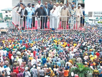 A tumultous crowd of traders, artisans and others, during a solidarity show for the Oyo State governor, Senator Abiola Ajimobi, at the secretariat, Ibadan, on Monday. Inset: Governor Ajimobi addressing the crowd.