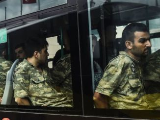 Soldiers detained for suspected coup involvement are brought to court in Istanbul. PHOTO: AFP