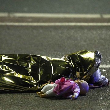 A child's doll lies on the street beside the body of a young girl who was killed in the attack. PHOTO: REUTERS