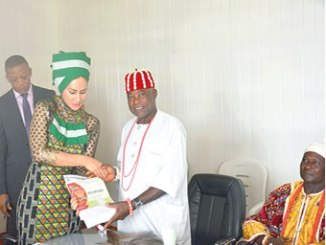 The Director General, Nigerian Tourism Development Corporation (NTDC) Mrs Sally Uwechue-Mbanefo receiving the invitation cards for the 2016 Iri Ji Ndi Igbo National New Yam Festival from the Igwe Akpugoeze, Oji River Local Government Area, Enugu State and His Royal Highness Igwe Dr. C. N Nwajaju during a courtesy visit to the Director General at the corporate headquarters of the Corporation in Abuja Recently.