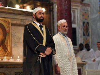 Imam Sami Salem (left) and Imam Mohammed Ben Mohammed stand before Mass in Rome. PHOTO: AFP