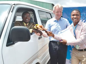 From left, provost, Federal Cooperative College, Ibadan, Dr. Oyebade Emmanuel Olusegun, presenting the key of a brand new bus to the Students' Union President, Mr. Mosaderin Mutiu Adewale; while the managing director, FanMilk Plc, Mr. Hans Pedersen, watches, at the FanMilk Plc premises in Eleyele, Ibadan on 14th June 2016.
