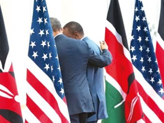 U.S. President Barack Obama (left) puts his arm around Kenya's President Uhuru Kenyatta as they depart after their joint news conference after their meeting at the State House in Nairobi, July 25, 2015. PHOTO: Jonathan Ernst.