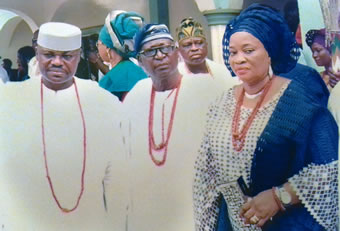 The father of Ooni of Ife (center), Prince John Oluropo Ogunwusi, and others at a function.