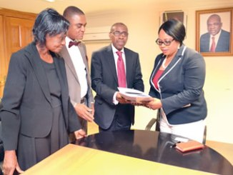 Chairman, Seaport Terminal Operators Association of Nigeria (STOAN), Princess Vicky Haastrup (right), receiving publications of the Maritime Arbitrators Association of Nigeria (MAAN) from its President, Dr Omogbai Omoeboh, as other executive council members of MAAN, Sir Osuola Nwagbara and Mrs Tosan Edodo-Emoren watch, during the visit of the MAAN executives to STOAN recently.