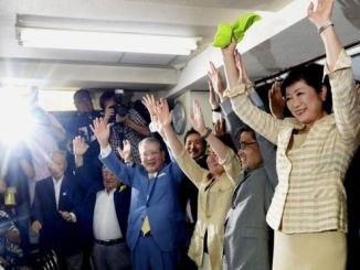 Yuriko Koike (right), celebrated with supporters after exit polls predicted her election victory. PHOTO: REUTERS