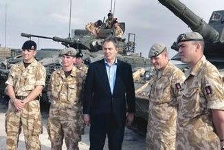 Then British Prime Minister Tony Blair meets soldiers at Shaibah logistics base, Basra, Iraq, Dec. 22, 2005. PHOTO: AP