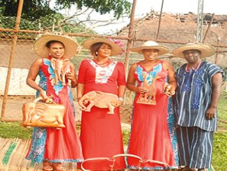 From left, Ms Olapeju Olayemi, with members of her team displaying handcrafted elephant-themed wood handbags after the seminar.