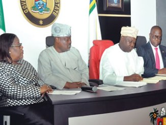 "From left, Lagos State Chief Judge,  Justice Olufunmilayo Atilade; Speaker, State House of Assembly, Honourable Mudasiru Obasa; Governor Akinwunmi Ambode and the Commissioner for Justice, Mr Adeniji Kazeem, at the signing of two bills on  ""Safety Activities"" and  ""Illegal Entry of Landed Properties"" into law, on Monday."