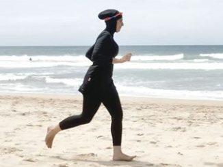 A woman wearing burkini, jogging on a beach. PHOTO: REUTERS