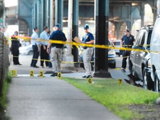 Members of the New York City Police Department establish a crime scene at the spot where Imam Alala Uddin Akongi was killed in the Queens borough of New York City, August 13, 2016. REUTERS