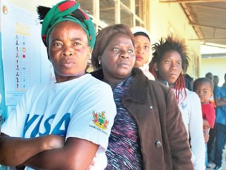 Citizens waiting to cast their vote at in polling unit in Zambia. PHOTO: AL JAZEERA