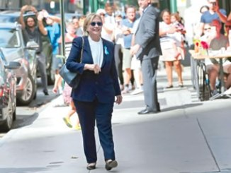 US Democratic presidential candidate, Hillary Clinton, leaves her daughter, Chelsea's home in New York, United States  after Clinton left ceremonies commemorating the 15th anniversary of the September 11 attacks feeling 'overheated.'  PHOTO: REUTERS