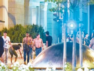 Asylum seekers (pictured) were accused of taking over the central square in Bautzen. PHOTO: AP