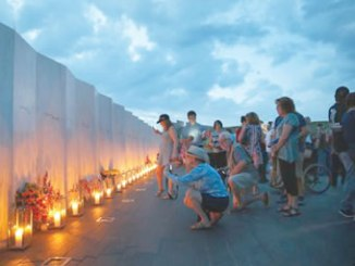 Candles in memory of the passengers and crew of Flight 93 are lit along the Wall of Names at the Flight 93 National Memorial in Shanksville, Pa., Sept. 10, 2016, as the nation marks the 15th anniversary  attacks. PHOTO: AP