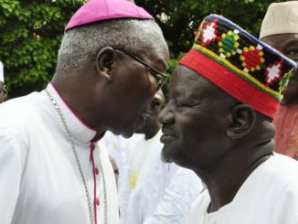 The Archbishop of Ouagadougou wishes a traditional chief a happy Eid. PHOTO: AFP