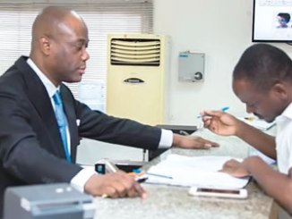 Group Managing Director/CEO, Access Bank Plc, Herbert Wigwe attending to a customer of the Bank in commemoration of 2016 Customer Service Week at the Bank's Branch on Idejo Street, Victoria Island, Lagos on Thursday.
