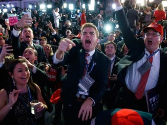 Supporters of Republican presidential candidate Donald Trump cheer as they watch election returns during an election night rally. PHOTO: AP