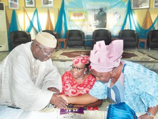From left, Director, African Newspapers of Nigeria (ANN) Plc, Chief Ayo Adebanjo; Co-chairman, Ambassador (Dr) Olatokunbo Awolowo Dosumu and the Chairman, Reverend (Mrs) Omotola Oyediran, at the 40th annual general meeting of ANN Plc, publishers of the Tribune titles, at Efunyela Hall, Ikenne, Ogun State, on Tuesday.  PHOTO: TOMMY ADEGBITE.
