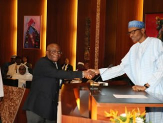 President Buhari swears in the new Acting Chief Justice of Nigeria, Hon Justice Walter Samuel Nkanu Onnoghen at the State House in Abuja.
