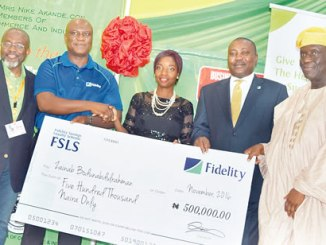 From left, Vice-President / Chairman, Trade Promotion Board Lagos Chambers of Commerce and Industry, (LCCI) Mr Sola Oyetayo; Regional Bank Head of Lagos Island, Fidelity Bank Plc, Mr Ifeanyi Nwosu; oneof the winners of the Fidelity Bank Plc save and win promo,  Miss Zainab Abdulrahman; Executive Director, Corporate Banking, Fidelity Bank Plc, Mr Adeyeye Adepegba and Deputy President, LCCI, Mr Babatunde Runwase, during Fidelity Bank Plc special day at the on-going 2016 Lagos International Trade Fair on Thursday in Lagos. Photo: Sylvester Okoruwa