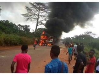 Heavy duty truck set ablaze close to the university gate. PHOTO: BANJI ALUKO