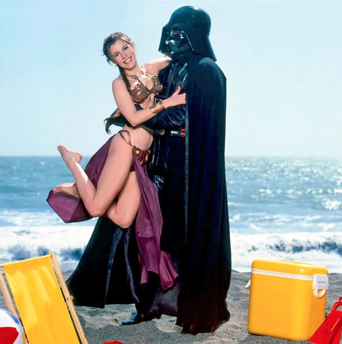 Playful 1983 Return of the Jedi Promo Photo - Slave Leia Jumping Into Darth Vader's Arms on the Beach