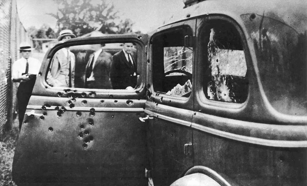 Photo showing Bonnie and Clyde Bullet Riddled Death Car