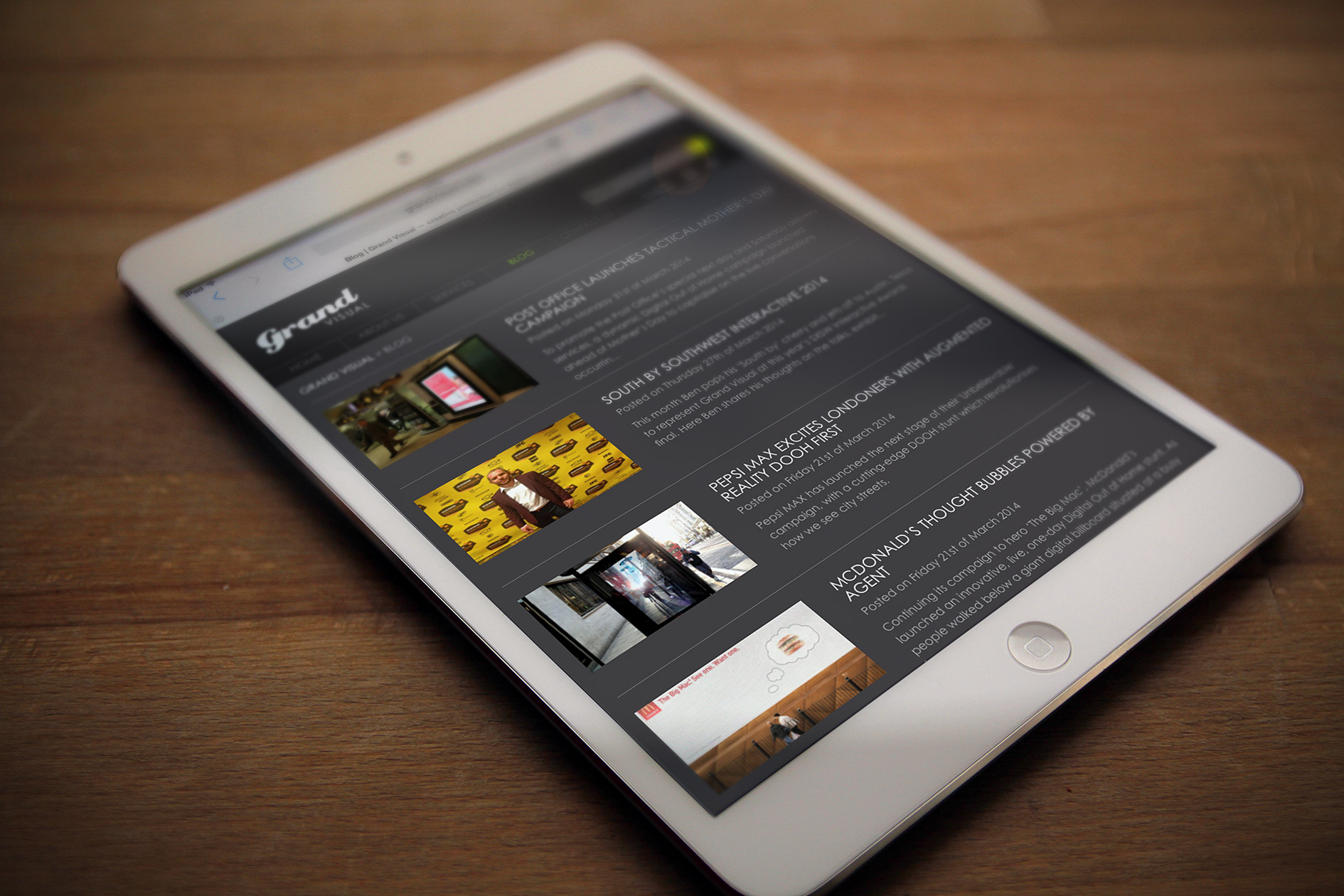 The Grand Visual website homepage displayed on a tablet device — Tribus Creative, web design for small business