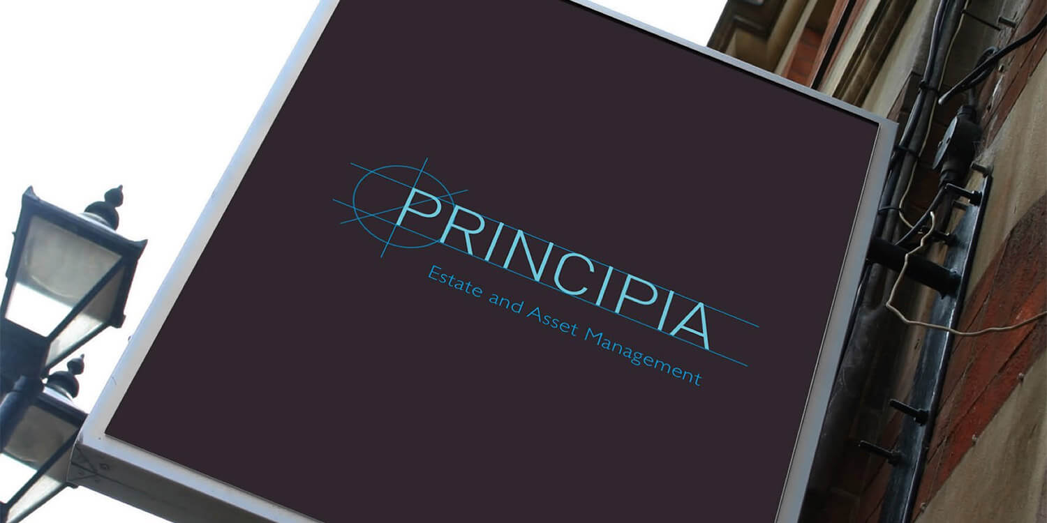 A photo of a sign featuring the new brand and brand identity for Principia