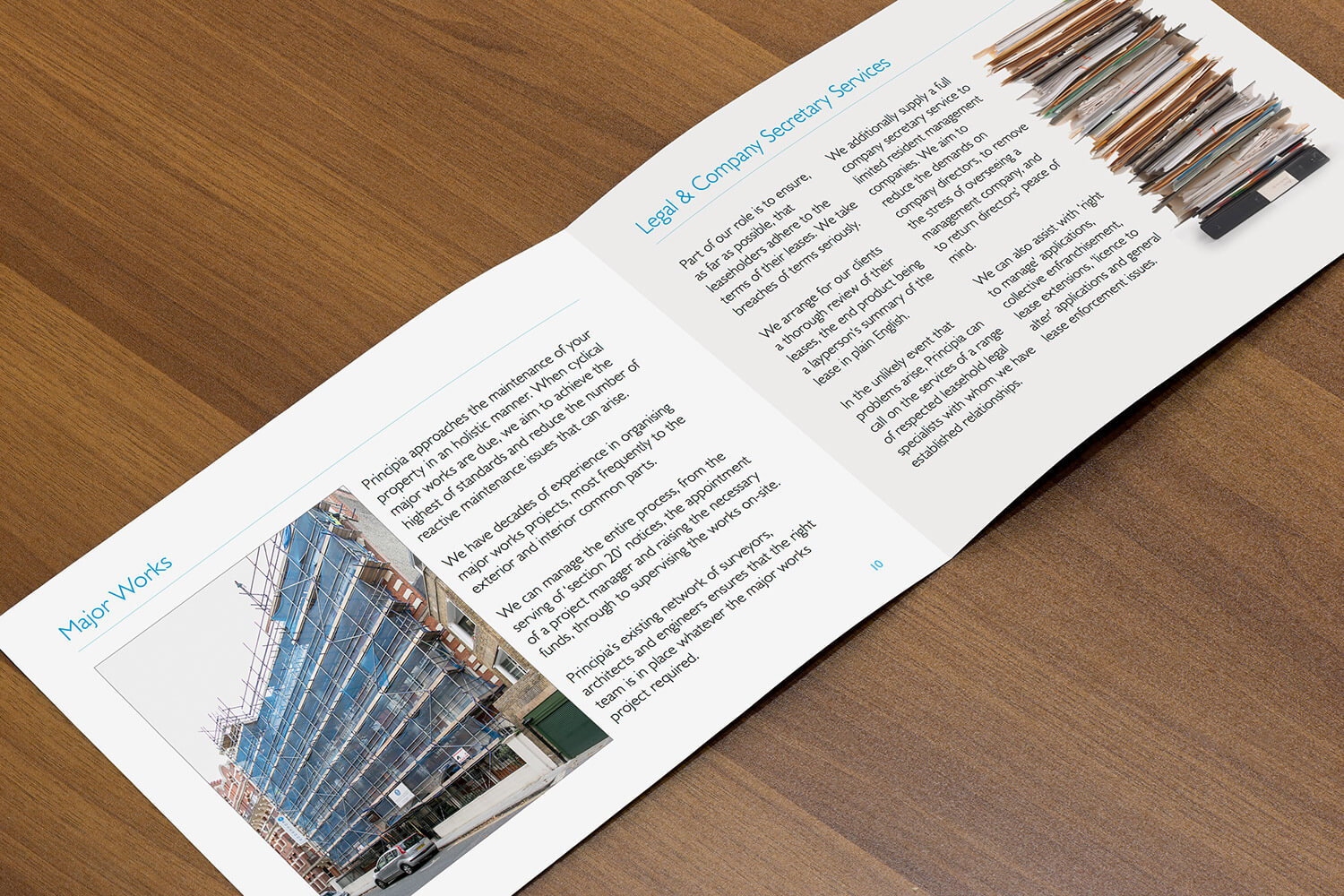 A photo of some of the Principia brochure page layouts