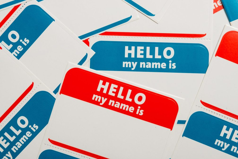 """A stack of blue and red """"Hello, my name is"""" name tags or badges"""