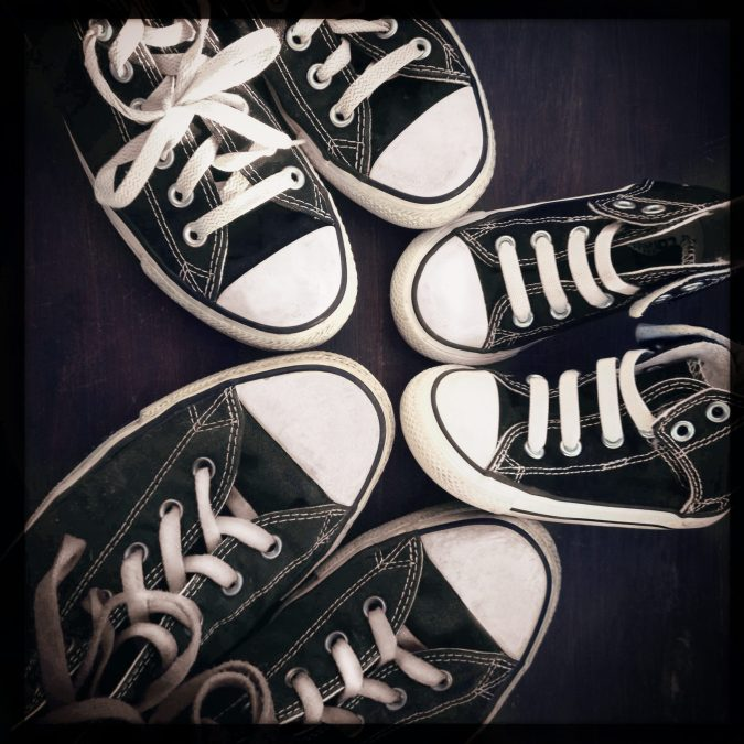 Instagram filtered image of a family concept, shoes in 3 sizes