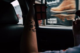 My sister Sam took this; I was putting on some makeup while in the car the way to our lunchdate. My tatts (henna) looked nice lol.
