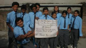 Group photo of DHC Newlife children with sign