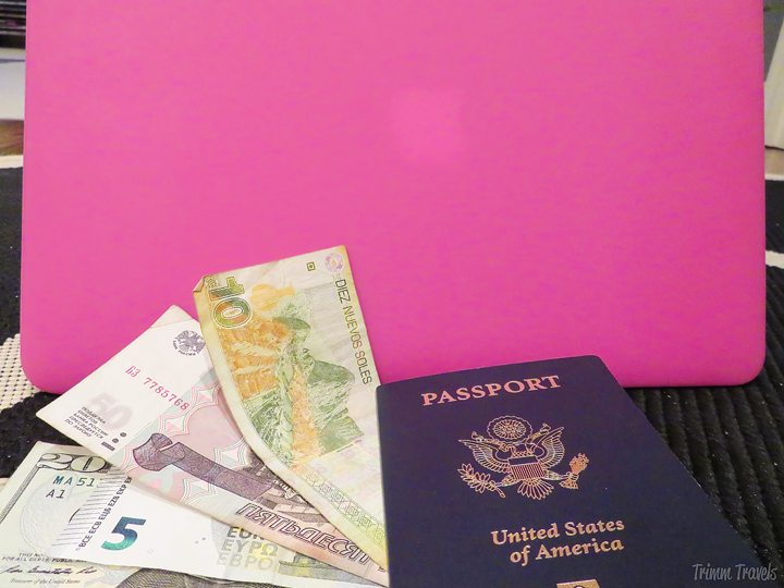 assorted currencies, passport and laptop-tips for easy packing process