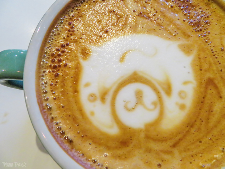 close up of the top of my latte with panda bear latte art in New York City
