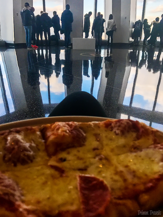 eating pizza at the top of One World Observatory in New York City