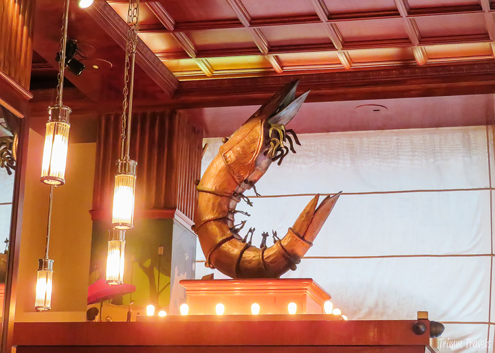 giant rotating bronze shrimp in Redeye Grill in New York City