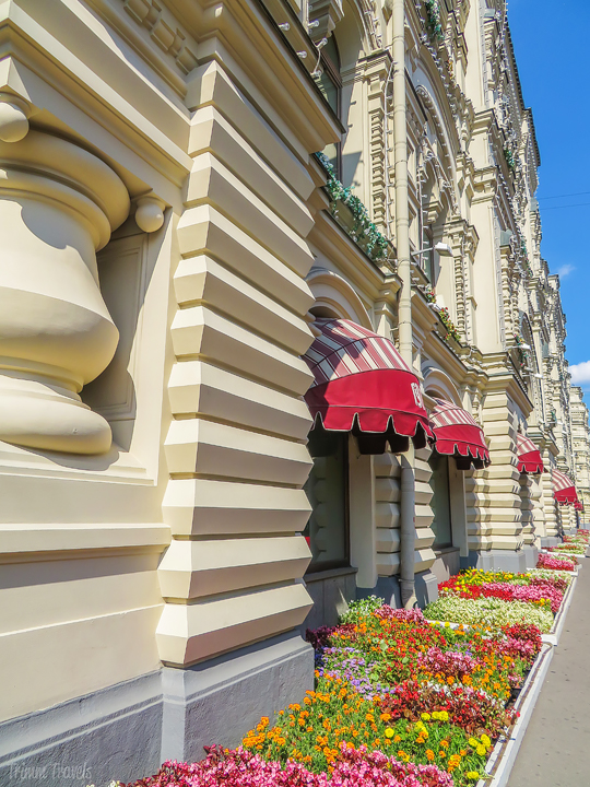 view of the flowers and side of the building of GUM in Moscow Russia