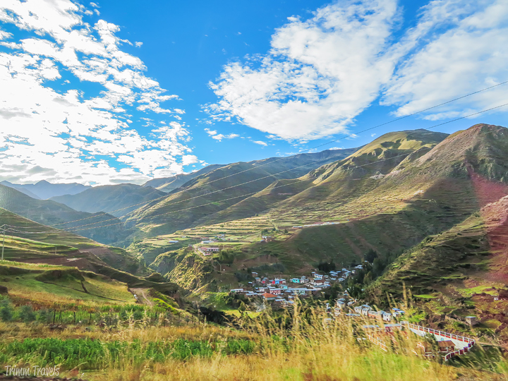valley with colorful small village in cusco region peru