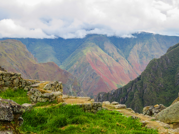 looking at red and green mountains at the back of machu picchu peru