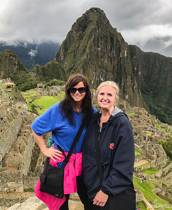 my friend and I with machu picchu peru in the background