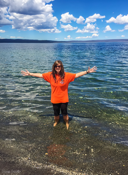 me standing in the freezing yellowstone lake