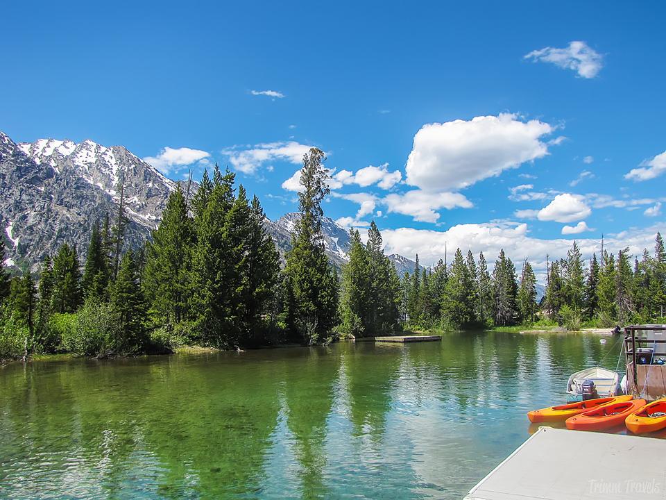 lake, mountains and orange canoes in grand teton
